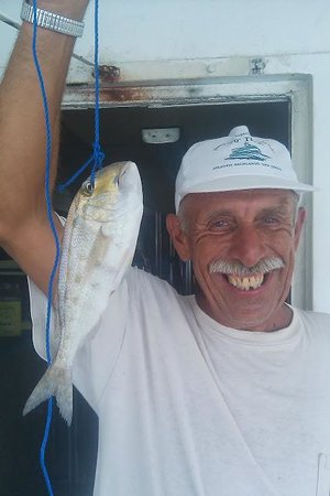 Hubbard's Marina: thanks bob one of our best customers having fun with a porgy . smokey