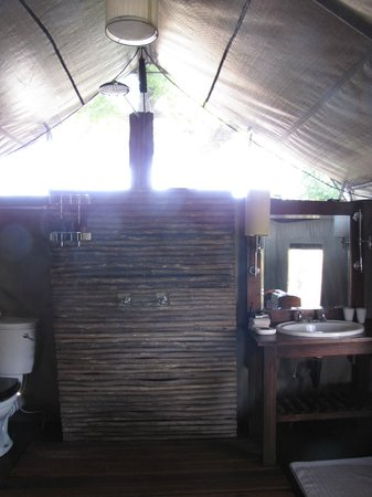 "andBeyond Nxabega Okavango Tented Camp : Bathroom (toilet, shower, sink, wardrobe all in one ""room"")"