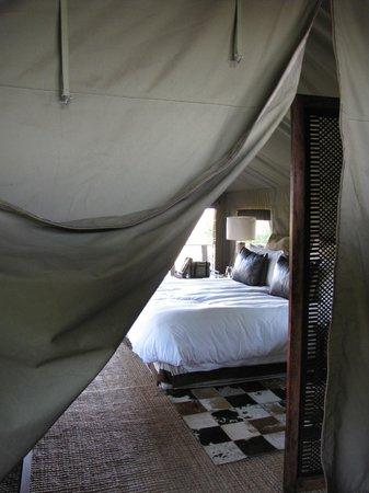 andBeyond Nxabega Okavango Tented Camp : Flap separating bedroom from bathroom