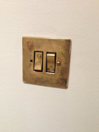 Holiday Inn Haydock M6, Jct 23 : The most worn out switch i have ever seen! Missing a screw also.