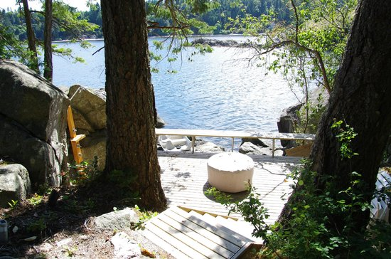 The Pointhouse at Sargeant Bay: Firepit deck with outdoor shower great for rinsing off after a dip in the chuck