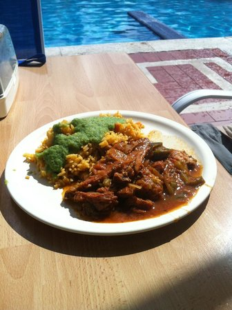 Hotel Cozumel and Resort: Slow cooked beef in a savory sauce with one of  5 rice dishes, & the best salsa verde we've ever