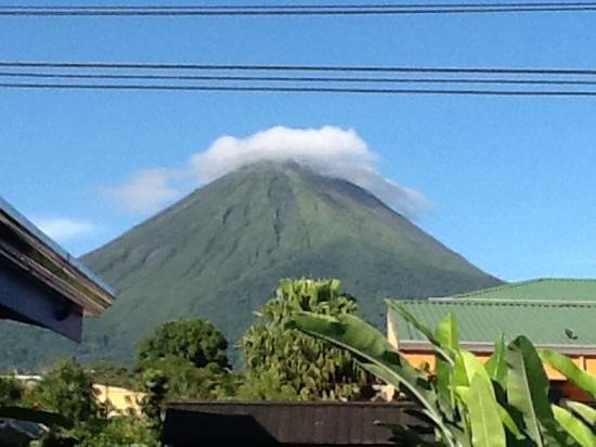 San Bosco Inn : Arenal volcano on a clear day as see from the pool.