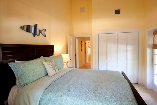 The Caribbean Resort at Sea Isle: Guest bedroom with reclaimed wood décor from Ocean Gardens