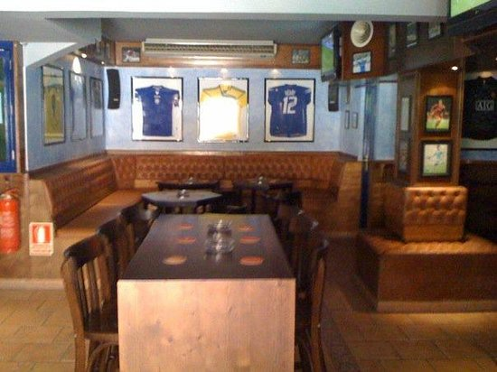 Linekers Bar Alcudia: Part of the main bar with official memorabilia.