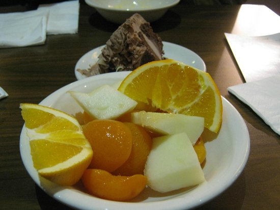 The Real China: Fruit for dessert plus frozen chocolate cake.
