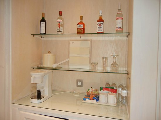 Excellence Punta Cana: Brand new bottles of liquor at mini bar in room