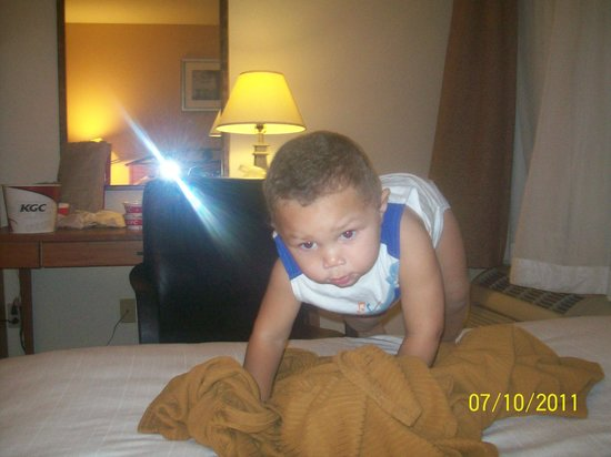 Holiday Inn Express Germantown: He calls this 'Our Hotel' ~ Learning to climb up on the high comfy bed.