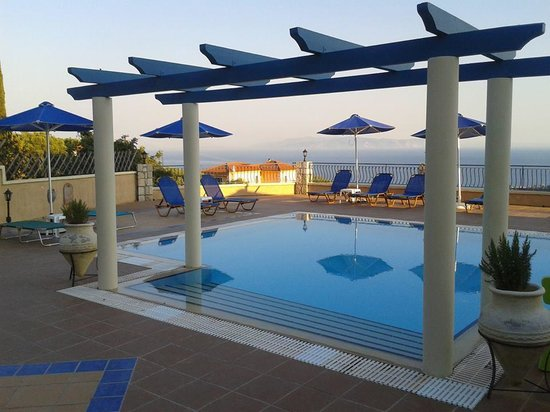 The very nice swimming pool at Diana studios, with mountains to the back and the Ionian sea and