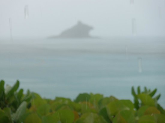 Hawksbill by Rex Resorts: Rain over Hawksbill Rock