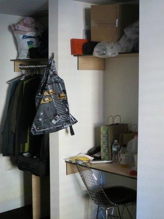 Pod 51 Hotel: closet, top shelf and desk area