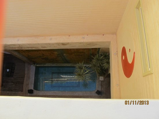 Riad Cocoon: looking down from roof terrace to pool