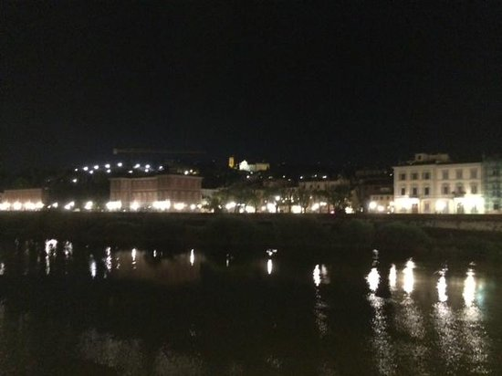 Hotel Silla: A view of the hotel and surroundings at night from the bridge over the Arno River.