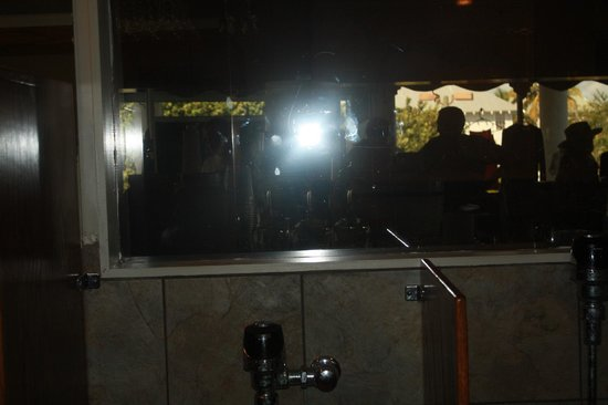 "Green Flash: The ""wall"" in the mens room, I can see you but you cant see me!  haha!"
