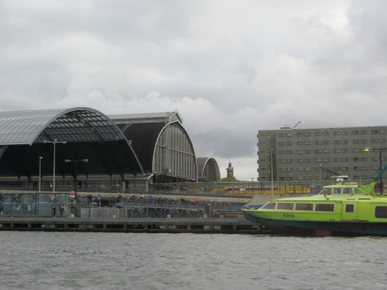Ibis Styles Amsterdam Central Station: View of Centraal Station and back of hotel from canal boat