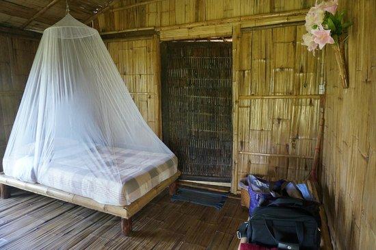 Bamboo Nest de Chiang Rai: Under the mosquito net