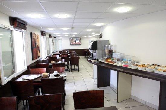 Hôtel Revotel : La salle petit-déjeuner