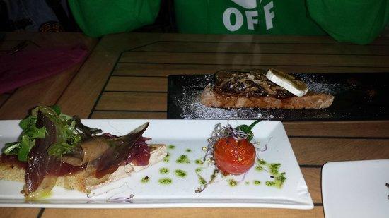 Sergio Megias Gastrobar : Tierra y mar de jamón de pato y anchoas y tosta de foie con queso de cabra