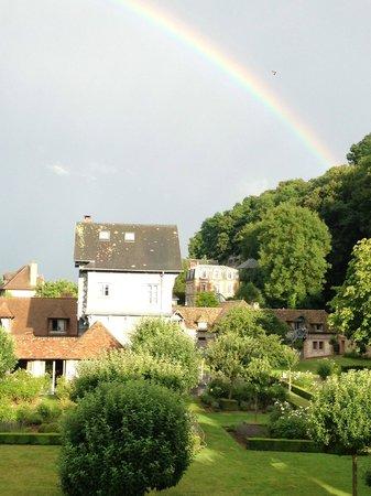 La Ferme Saint Siméon - Relais et Châteaux : An evening rainbow over the gardens