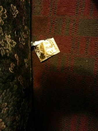 Manchester, CT: Condom wrapper on the floor of a room