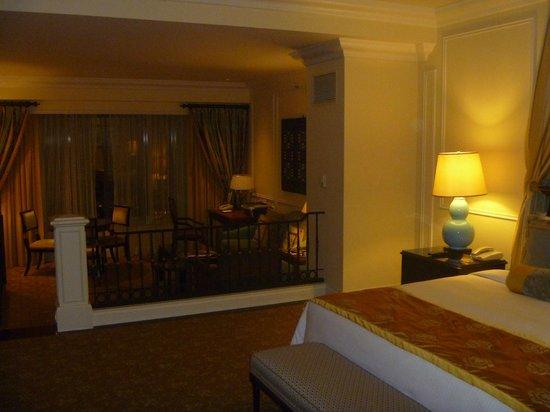 The Venetian Macao Resort Hotel: Bedroom foreground, living room background towards window