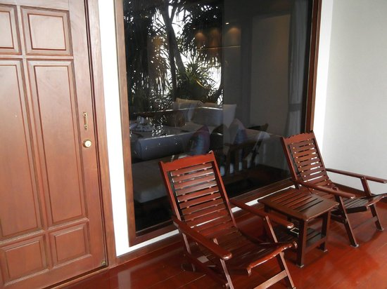 Marina Phuket Resort: Deck Chairs and picture window from bedroom
