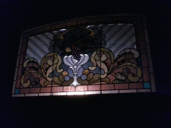 Old Northside Bed and Breakfast Inn: Window above the bed at night (Night Light)