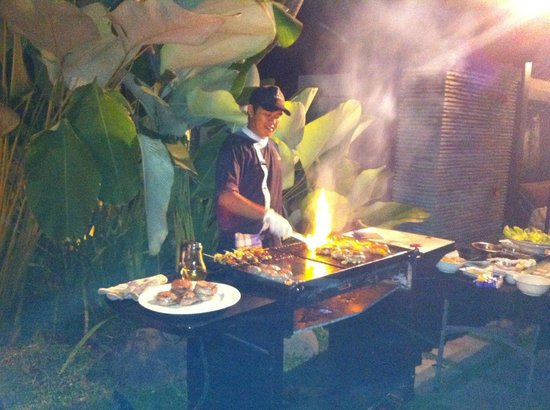 Peppers Seminyak : Our chef cooking in our villa.