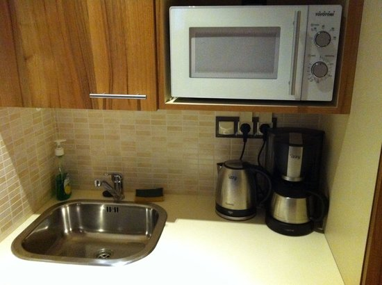 Elements Hotel Apartments: A small kitchen.