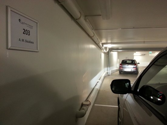 Ocean Comfort Apartments: private indoor parking with our names written on the wall.
