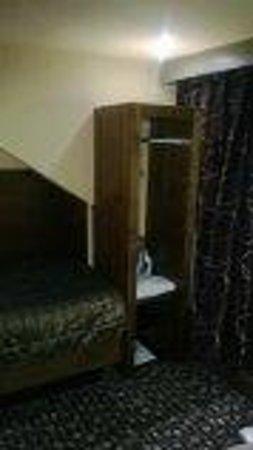 The Rutland Hotel: Wardrobe at Bottom of bed