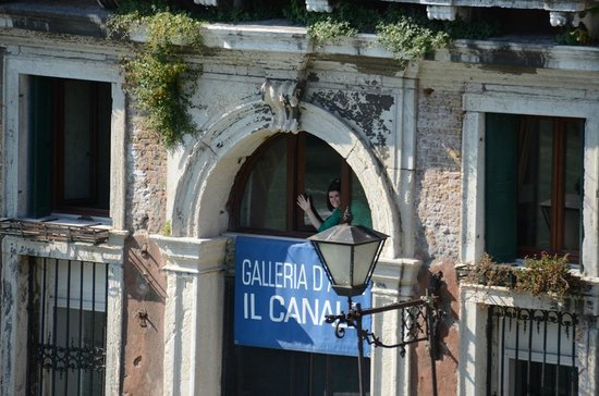 Hotel Galleria: View from Accademia Bridge of my friend waving from her room (#8) - in the crescent window.