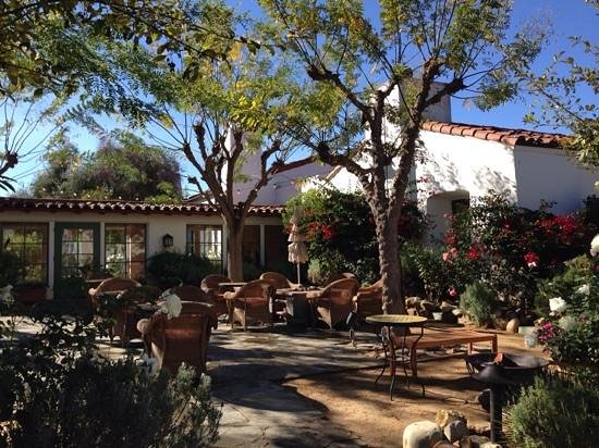 Ojai Valley Inn : at night this patio is lit up and has firepits going