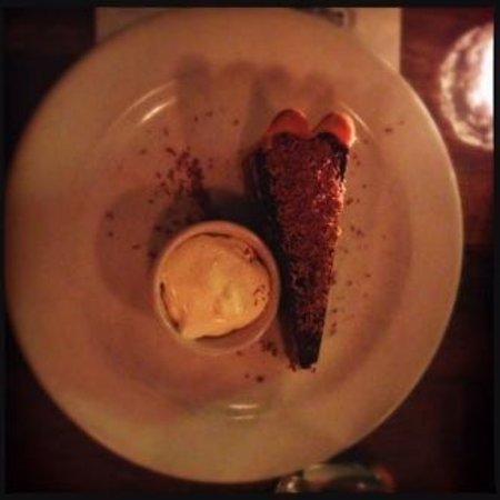 Juniors: Dark chocolate, caramel & peanut tart