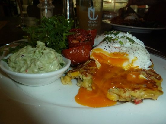Taylor's Cafe: Golden eggs oozing over corn fritters, with guacamole, rocket & added slow-roasted tomatoes