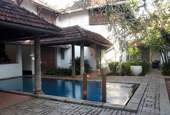 Malabar House : The pool is tucked just behind the open-air reception area