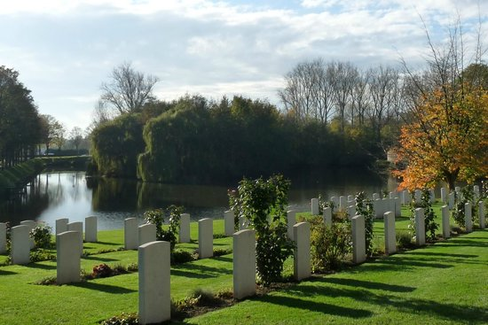 Tranquil Ramparts Cemetery , overlooking the moat.
