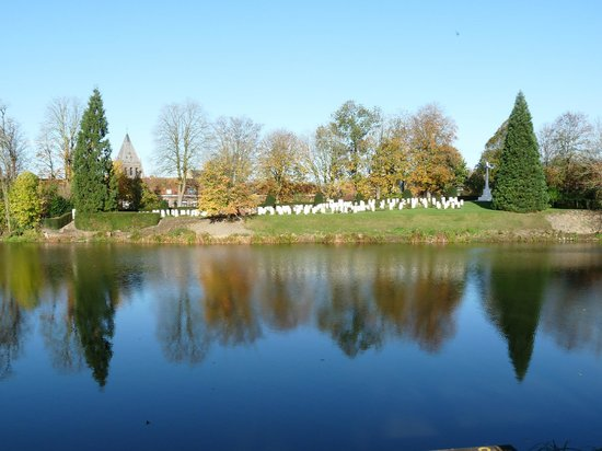 Ramparts Cemetery : The beauty of the cemetery from near the Lille Gate, looking  acrosss the moat