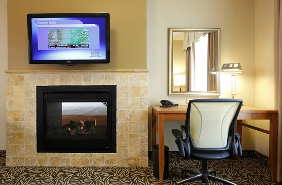 Hilton Garden Inn Cedar Falls: Our two room fireplace suites offer romantic getaways with see through fireplaces.