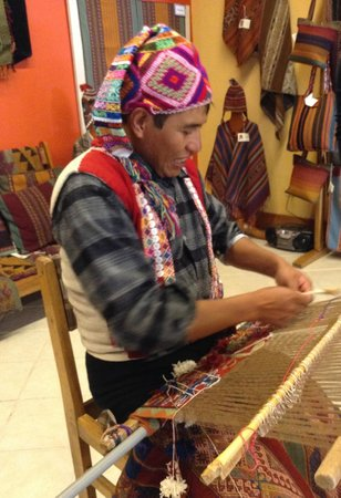 Centro de Textiles Tradicionales del Cusco: A highly skilled tapestry weaver from Pitumarca demonstrating his handwork.
