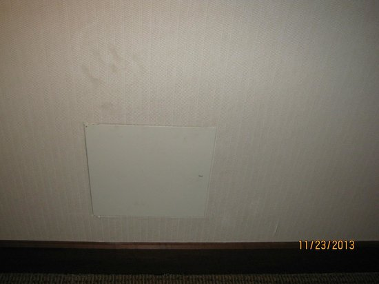 Hotel Alyeska: Hand print on wall near maintenance panel and peeling wallpaper
