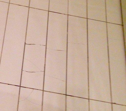 The Light ApartHotel: Broken floor tiles in bathroom tiles