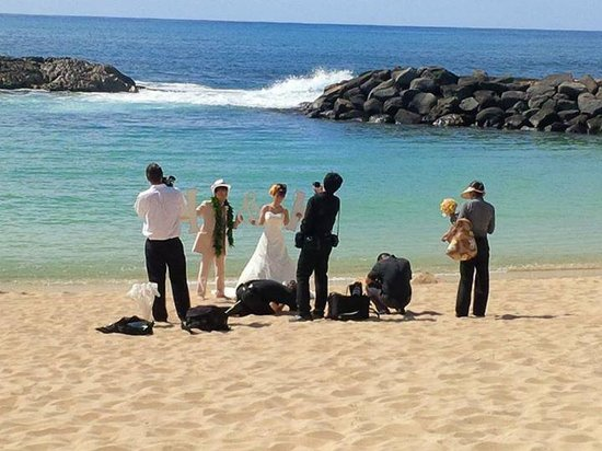 Ko Olina Lagoons: newly married couple taking wedding photos at one of four lagoons