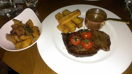 Monteiths: Ribeye steak with duck fat chips, a side of peppercorn sauce and a side dish of roasted pumpkin.