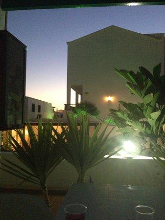 Blue Sea Los Fiscos: The balcony at night
