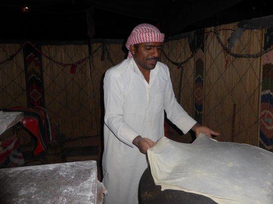 Captain's Desert Camp: Making bread on the hot stone