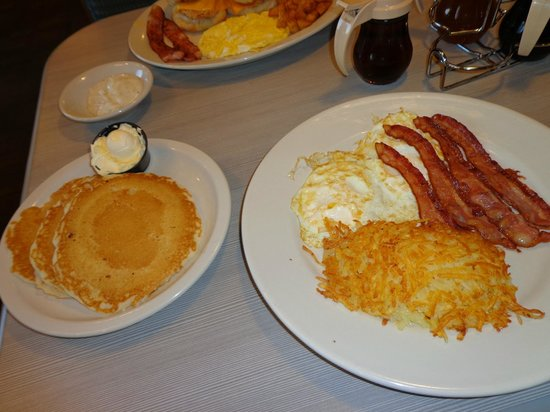 Perkins Restaurant & Bakery: classic egg favorites, with four bacon strips, hash browns and 3 pancakes