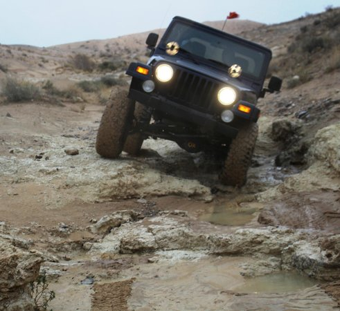 Las Vegas Rock Crawlers: Nellis Apex going through some rock and mud after the rain