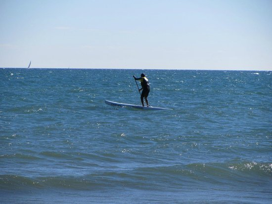 The Beach Village: Paddle surfer