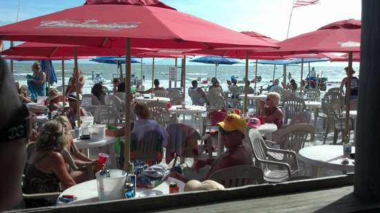 The Beach Pub: Tables in the sand.